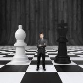 Businessman on chessboard — Stock Photo