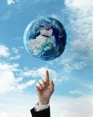 Hand pushing at earth — Stock Photo