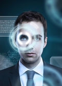 Man with eye interface — 图库照片
