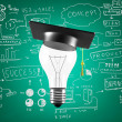 Stock Photo: Lightbulb with graduation hat