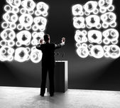 Businessman standing on stage — Stock Photo