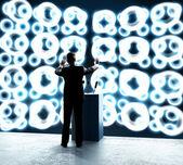 Businessman standing on rostrum — Stock Photo