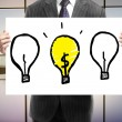 Placard with three lightbulb — Stockfoto