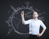 Businessman drawing travel — Stock Photo