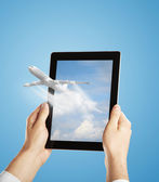 Touch pad with airplane — Stock Photo