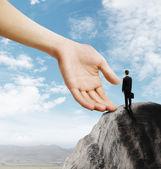 Businessman standing on mountain — Stock fotografie