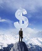 Man looking at big dollar — Stock Photo