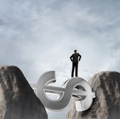 Businessman stands on dollar — Stock Photo