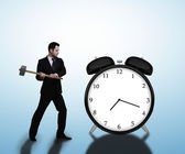 Businessman breaks clock — Stock Photo