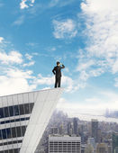 Man standing on roof — Stock Photo