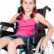 Young handicapped girl in a wheelchair over white background. — Stock Photo #25261769