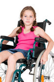 Young handicapped girl in a wheelchair over white background. — Stock Photo