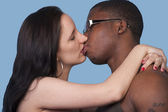 Passionate kiss a white woman and black man — Stock Photo