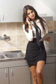 Business women in the kitchen — Stockfoto