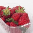 Strawberries in plastic packaging — Stockfoto