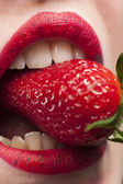 Strawberry in the mouth — Stock Photo