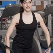 Stock Photo: Beautiful fit womat gym smiling