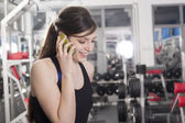 Mobile phone in gym — Stock Photo