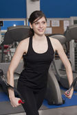Beautiful fit woman at the gym smiling — Stock Photo