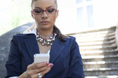 Businesswoman using smartphone — Stock Photo