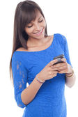 Young woman text messaging — Stockfoto