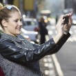 Capturing the moment with a smartphone — Stock Photo #35798175