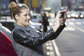 Capturing the moment with a smartphone — Stock Photo