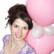 Pretty smiling girl with balloons — Stock Photo