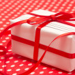 White gift box with red bow - Stock Photo