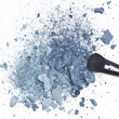 Crushed blue eyeshadow with makeup brush - Stock Photo