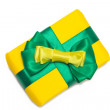 Yellow gift box with green ribbon — Stock Photo