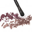 Crushed eyeshadow with makeup brush — Stock Photo