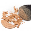Crushed cosmetic powder with makeup brush — Stock Photo