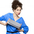 Stylish beautiful brunette with clutch — Stock Photo