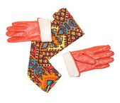 Convolute bright patterned scarf and orange gloves — Stock Photo