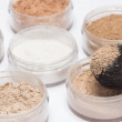 Stock Photo: Loose cosmetic powder in jars