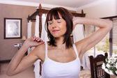 Woman in luxury bedroom. — Stock Photo