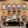 Vintage car and Italian building. - Stock Photo