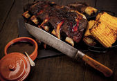Barbequed beef ribs and corn. — Stock Photo