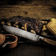 Royalty-Free Stock Photo: Barbequed beef ribs and corn.