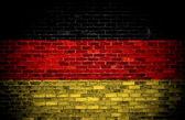 German flag on brick. — Stock Photo