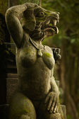 Statues with dog head and woman body — Stock Photo