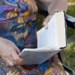 Older person reading — Stock Photo