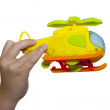 Child hand playing with the plane — Stock Photo