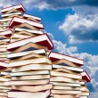 Stacked with books background — Stock Photo
