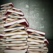 Books stacked with formulas fund, education — Stock Photo