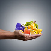 Hands with healthy, natural foods, juice and weights for exercise — Stock Photo