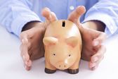 Hands holding pink pig piggy bank, economics and finance — Stock Photo