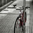 Old bicycle parked on sidewalk — Stock Photo #34964353