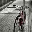 Old bicycle parked on the sidewalk — Stock Photo